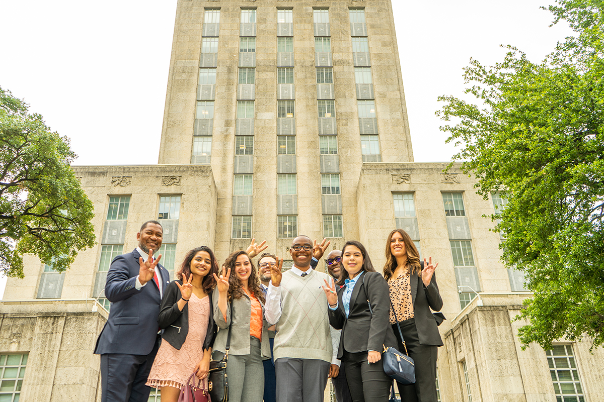 Dean Tillis, CLASS associate deans Drs. Billy Hawkins and Todd Romero, student interns Anu Thomas, Samantha Annab, London Douglas, Jessica Ortega, and Brittney Wallace outside of City Hall.