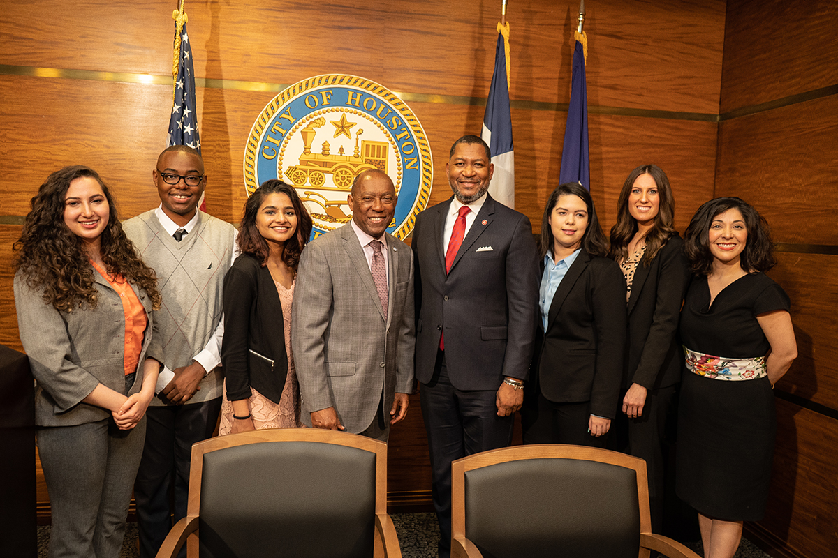 Houston Mayor Sylvester Turner, Dean Tillis, student interns Samantha Annab, London Douglas, Anu Thomas, Jessica Ortega, Brittney Wallace, and Juliet Stipeche, director of education for the City of Houston.