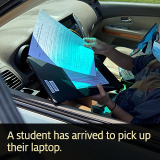 A student has arrived to pick up their laptop.