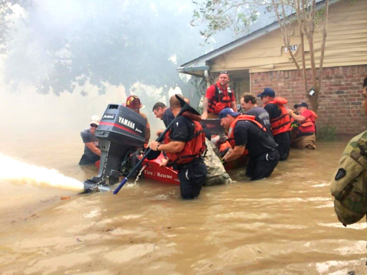 Firefighters rescuing people
