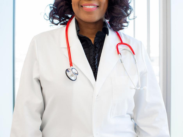 A person wearing a white coat