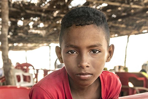An unhappy young Hispanic boy.