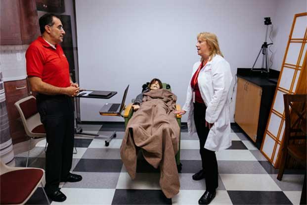 UH nursing leadership discusses palliative care mannequins.