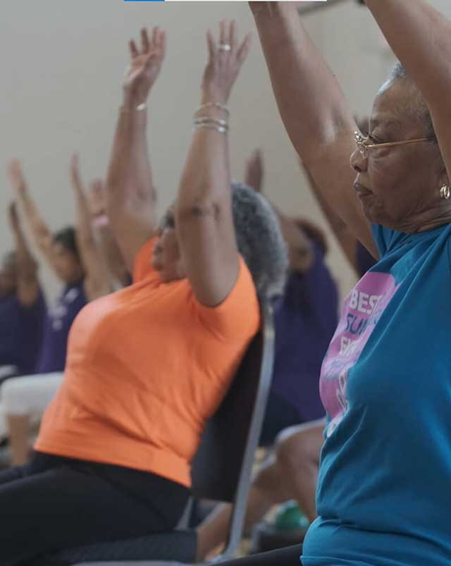 Community members participate in a group exercise class facilitated by UH TOUCH.