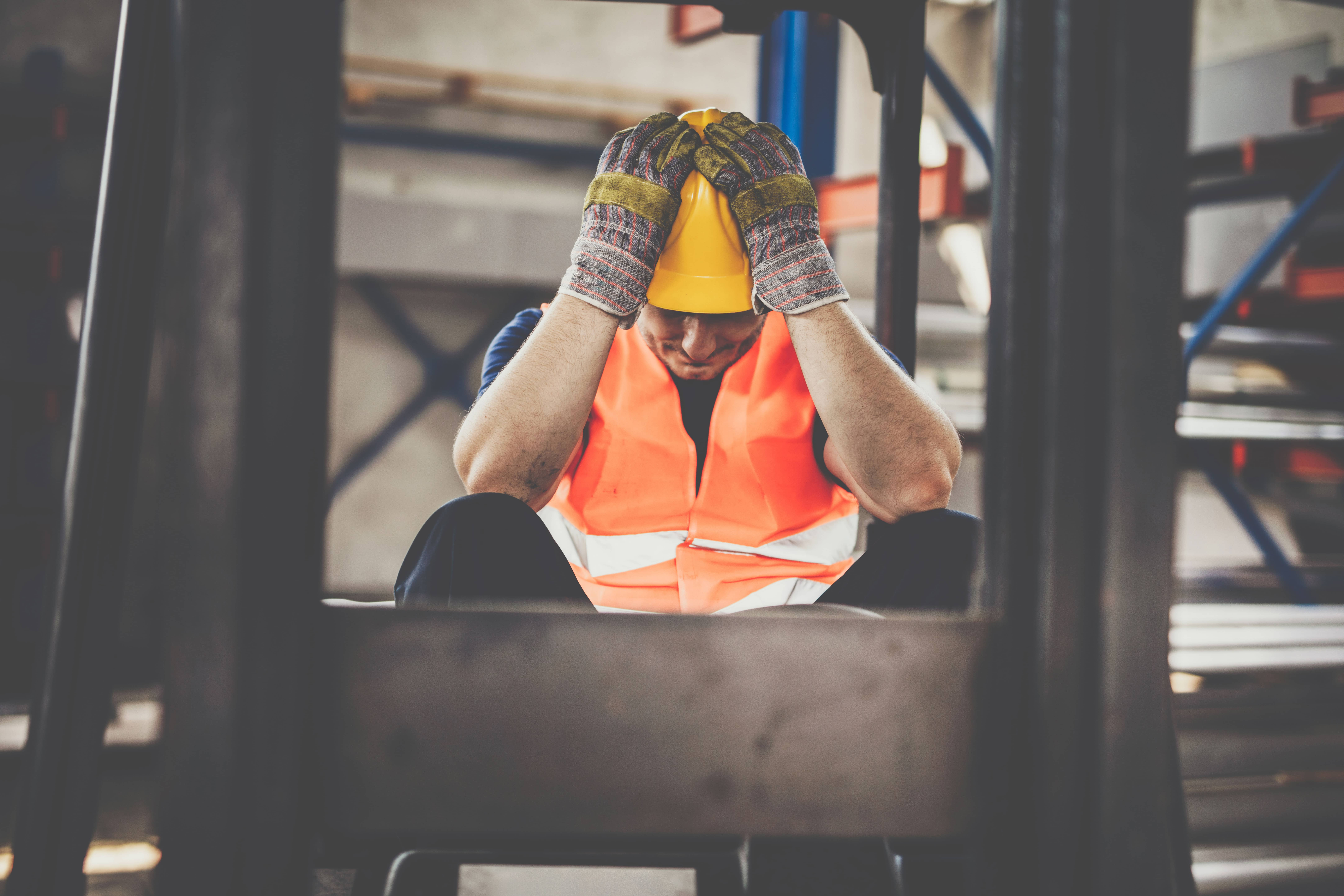 A worried construction worker.