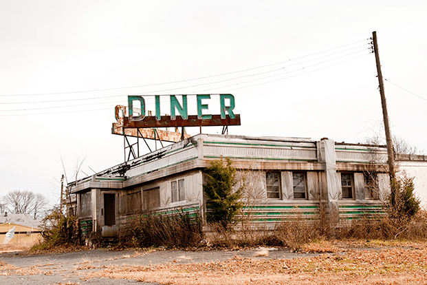 A closed-down diner in the desert.