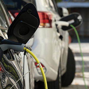 Closeup view of an electric vehicle being charged