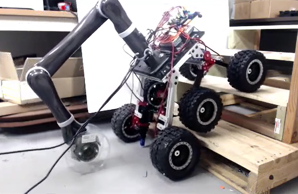 Service Robot Development - Video of service robot traversing stairs with the aid of a robotic arm