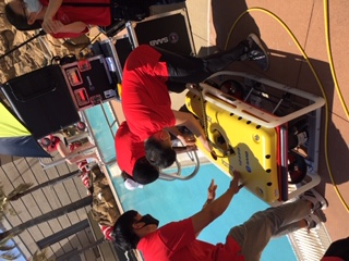 Asset Integrity of Valves and Bolted Connections Project Photo - Researchers surrounding underwater robot poolside