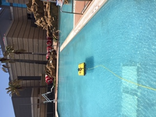 Asset Integrity of Valves and Bolted Connections Project Photo - Underwater robot partially submerged in pool